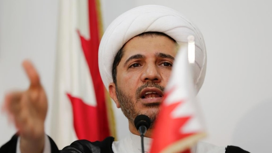 Sheik Ali Salman, leader of the main Shiite opposition group Al-Wefaq, explains why his and other opposition groups are refusing to participate in upcoming elections at a press conference in Manama, Bahrain, Saturday, Oct. 11, 2014. Opposition leaders announced Saturday that the Al-Wefaq society and four smaller groups will boycott the Nov. 22 parliamentary and municipal elections in the Gulf island kingdom. A Bahraini flag is seen at left. (AP Photo/Hasan Jamali)