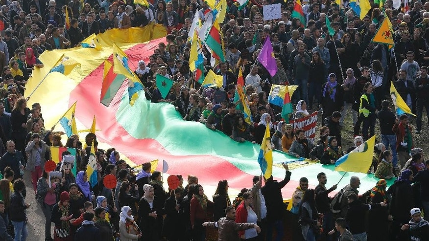 Some thousand Kurds protest against the Islamic State militants attack on the Syrian city Kobani in Duesseldorf, Germany, Saturday, Oct. 11, 2014. (AP Photo/Frank Augstein)