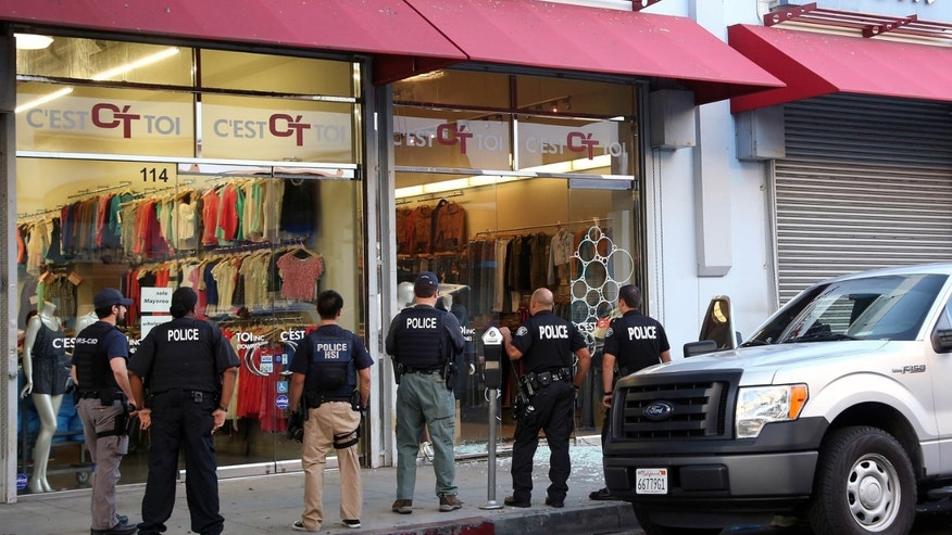 Law enforcement agents after a raid in the Los Angeles Fashion District, Sept. 10, 2014.