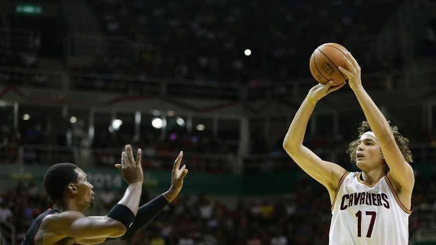 Cleveland Cavaliers' Anderson Varejao aims to shoot as Miami Heat's Chris Bosh defends during a NBA preseason basketball game that's part of the NBA Global Games, in Rio de Janeiro, Brazil, Saturday, Oct. 11, 2014. (AP Photo/Felipe Dana)