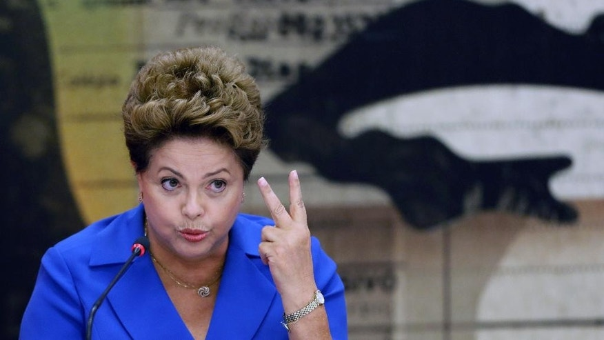 Brazil's President Dilma Rousseff, who is running for re-election with the Workers Party, PT, speaks during a campaign meeting with governors from states that are members of her political coalition in Brasilia, Brazil, Tuesday, Oct. 7, 2014. President Rousseff will face challenger Aecio Neves in a second-round vote in Brazil's most unpredictable presidential election since the nation's return to democracy nearly three decades ago. (AP Photo/Eraldo Peres)