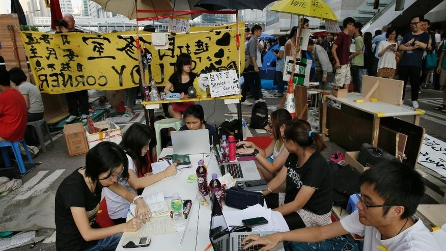 Oct. 11, 2014: Pro-democracy students do their homework at a study area at a main road in the occupied areas in Hong Kong's Admiralty district. (AP)