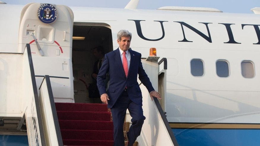 U.S. Secretary of State John Kerry arrives at Cairo International Airport Sunday, Oct. 12, 2014, to attend a reconstruction conference for Gaza. (AP Photo/Carolyn Kaster, Pool)
