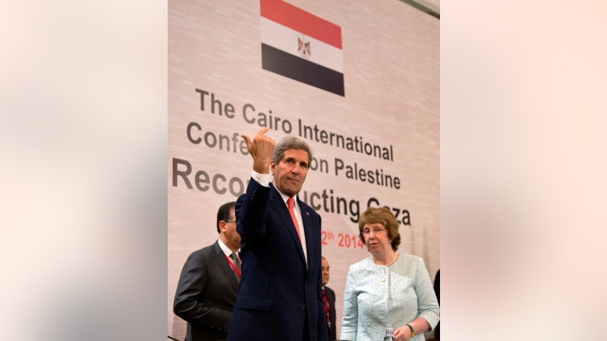 U. S. Secretary of State John Kerry and European Union High Representative Catherine Ashton, right, look out from the dais, in Cairo, Egypt, Sunday, Oct. 12, 2014, during the Gaza Donor Conference. (AP Photo/Carolyn Kaster, Pool)