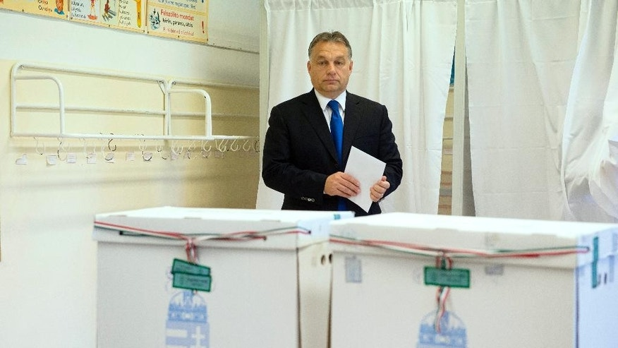 Hungarian Prime Minister and Chairman of center right Fidesz party Viktor Orban before casting his vote during municipal elections in Budapest, Hungary, Sunday, Oct. 12, 2014. (AP Photo/MTI, Szilard Koszticsak)