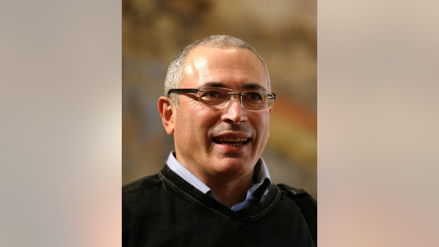 Russian former oil tycoon Mikhail Khodorkovsky smiles prior his speech at an opening of the Forum 2000 conference in Prague, Czech Republic, Sunday, Oct. 12, 2014. The Forum 2000 Foundation pursues the legacy of Vaclav Havel by supporting the values of democracy and respect for human rights. (AP Photo/Petr David Josek)