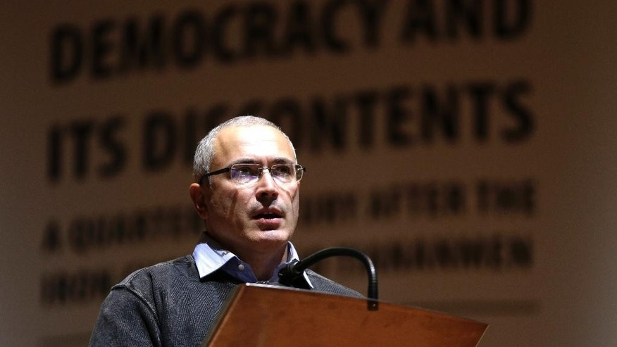 Russian former oil tycoon Mikhail Khodorkovsky speaks at the opening of the Forum 2000 conference in Prague, Czech Republic, Sunday, Oct. 12, 2014. The Forum 2000 Foundation pursues the legacy of Vaclav Havel by supporting the values of democracy and respect for human rights. (AP Photo/Petr David Josek)