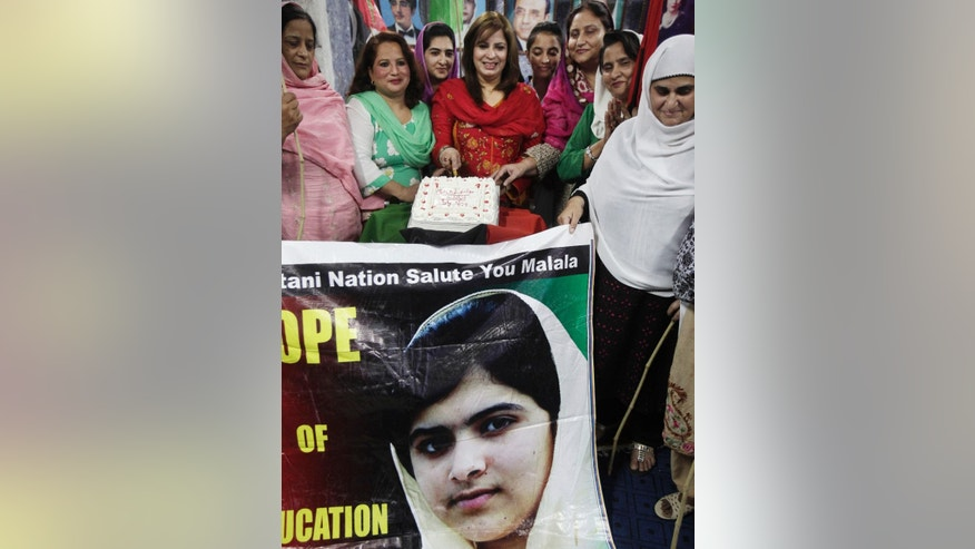 Female supporters of Pakistan People's Party cut a cake to celebrate Nobel Peace Prize winner Malala Yousafzai, who survived the Taliban's attack, at a ceremony in Islamabad, Pakistan, Saturday, Oct. 11, 2014. Taliban attack survivor Malala became the youngest Nobel winner ever as she and Kailash Satyarthi of India won the Nobel Peace Prize on Friday for working to protect children from slavery, extremism and child labor at great risk to their own lives. (AP Photo/Anjum Naveed)