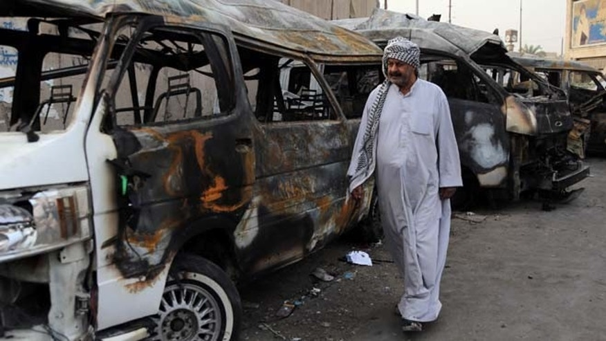 Oct. 12, 2014: A man looks at the site of a car bomb attack in the Shula neighborhood of Baghdad, Iraq. (AP)