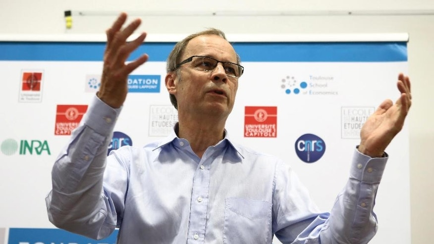 French economist and Nobel Prize laureate Jean Tirole addresses the media during a press conference at the Toulouse School of Economics in Toulouse, southern France, Monday, Oct. 13, 2014. Tirole won the Nobel prize for economics Monday for research on market power and regulation that has helped policy-makers understand how to deal with industries dominated by a few powerful companies. (AP Photo/Fred Scheiber)