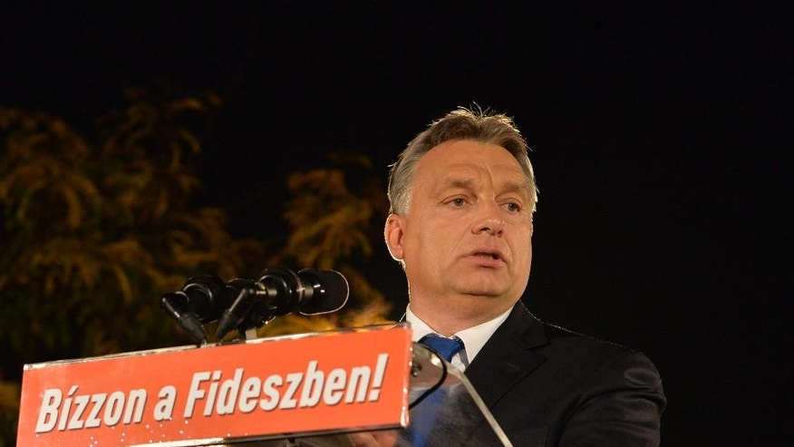 Hungarian Prime Minister Viktor Orban delivers a speech after incumbent mayor of Budapest Istvan Tarlos and candidate of the ruling centre-right Fidesz party won the mayoral election in Budapest, Hungary, Sunday, Oct. 12, 2014. Orban's Fidesz was the clear winner in Sunday's nationwide municipal elections, with the left-wing opposition making only some gains in Budapest and candidates from the far-right Jobbik party winning in several rural cities. (AP Photo/MTI, Szilard Koszticsak)