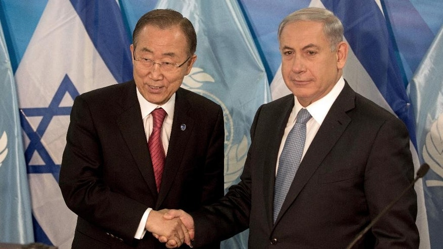 "U.N. Secretary-General Ban Ki-Moon, left, and Israeli Prime Minister Benjamin Netanyahu pose for a picture during a press conference at the prime minister's office in Jerusalem, Oct, 13, 2014. Ban thanked Israel for supporting the Gaza reconstruction efforts, but urged an easing of a longstanding blockade of Gaza. Israel and Egypt imposed the blockade after the Hamas takeover, largely restricting the movement of people and goods in and out of Gaza and stifling the local economy. Netanyahu said the ""root cause"" of the war was Hamas rocket attacks on Israeli cities. (AP Photo/Menahem Kahana, Pool)"