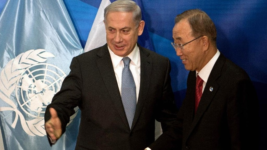 "Israeli Prime Minister Benjamin Netanyahu, left, and U.N. Secretary-General Ban Ki-Moon give a press conference at the prime minister's office in Jerusalem, Oct, 13, 2014. In Jerusalem, Ban thanked Israel for supporting the Gaza reconstruction efforts, but urged an easing of a longstanding blockade of Gaza. Israel and Egypt imposed the blockade after the Hamas takeover, largely restricting the movement of people and goods in and out of Gaza and stifling the local economy. Netanyahu said the ""root cause"" of the war was Hamas rocket attacks on Israeli cities. (AP Photo/Menahem Kahana, Pool)"