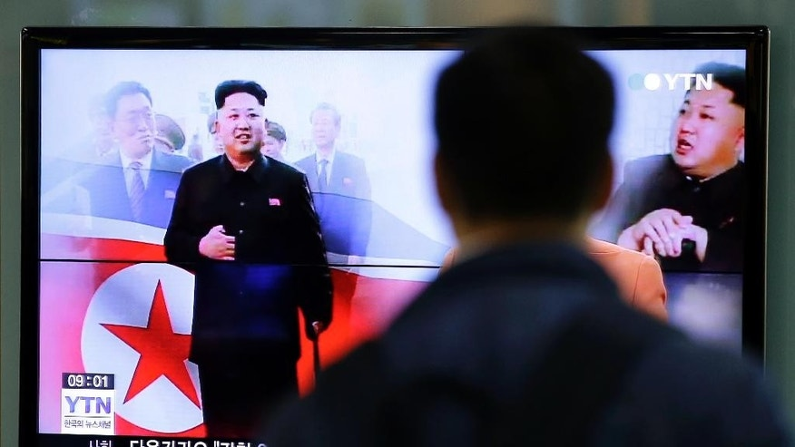 A man watches a TV news program showing North Korean leader Kim Jong Un using a cane during his first public appearance, at the Seoul Railway Station in Seoul, South Korea, Tuesday, Oct. 14, 2014. North Korean Leader Kim Jong Un has made his first public appearance in five weeks, state media reported Tuesday, ending an absence that drove a frenzy of global speculation that something was amiss with the country's most powerful person. (AP Photo/Lee Jin-man)