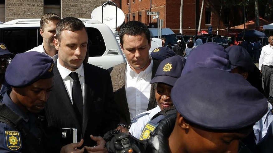 Oscar Pistorius arrives at the high court in Pretoria, South Africa, Monday, Oct. 13, 2014. Pistorius faces sentencing this week in a South African court after being convicted of culpable homicide for killing girlfriend Reeva Steenkamp. The sentencing of the double-amputee athlete is expected to involve several days of legal argument and testimony during which Judge Thokozile Masipa will assess what kind of penalty Pistorius deserves for shooting Steenkamp through a closed toilet door in his house. (AP Photo/Themba Hadebe)
