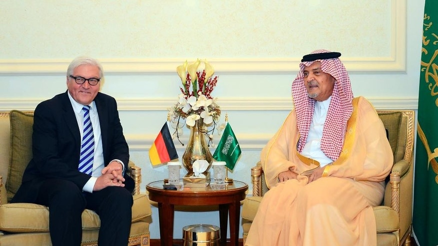 "In this photo released by Saudi Press Agency, German Foreign Minister Frank-Walter Steinmeier, left, meets with Saudi Arabia's Foreign Minister Saud al-Faisal in Jeddah, Saudi Arabia, Monday, Oct. 13, 2014. During a joint press conference, al-Faisal lashed out at regional rival Iran, accusing the Shiite powerhouse of having forces inside Syria, Iraq and Yemen, and insisting that Iran is ""part of the problem"" in trying to defuse the myriad Mideast crises. Saudi Arabia is part of the U.S.-led coalition conducting air strikes against Islamic State fighters who have taken over parts of Iraq and Syria. (AP Photo/SPA)"