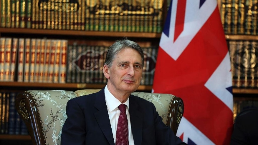 Britain's Foreign Secretary Philip Hammond meets with his Iraqi counterpart Ibrahim al-Jaafari in Baghdad, Iraq, Monday, Oct. 13, 2014. Hammond said coalition airstrikes will not be enough to defeat the Islamic State group, though he also ruled out the use of foreign ground forces. The British government is taking part in the U.S.-led aerial campaign combating the Islamic State group. However, it has refused to join the U.S.-led airstrike campaign in Syria. (AP Photo/Karim Kadim)