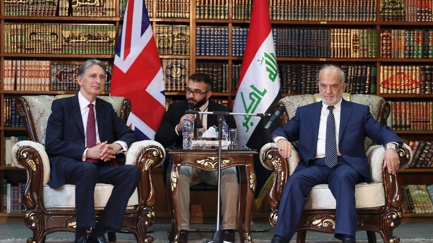 Britain's Foreign Secretary Philip Hammond, left, meets with his Iraqi counterpart Ibrahim al-Jaafari, right, in Baghdad, Iraq, Monday, Oct. 13, 2014. Hammond said coalition airstrikes will not be enough to defeat the Islamic State group, though he also ruled out the use of foreign ground forces. The British government is taking part in the U.S.-led aerial campaign combating the Islamic State group. However, it has refused to join the U.S.-led airstrike campaign in Syria. (AP Photo/Karim Kadim)
