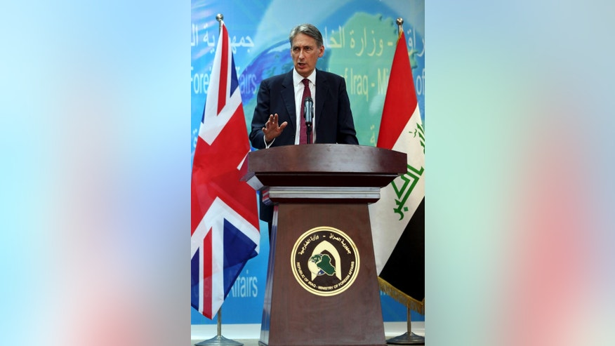 Britain's Foreign Secretary Philip Hammond, speaks during a press conference in Baghdad, Iraq, Monday, Oct. 13, 2014. Hammond said coalition airstrikes will not be enough to defeat the Islamic State group, though he also ruled out the use of foreign ground forces. The British government is taking part in the U.S.-led aerial campaign combating the Islamic State group. However, it has refused to join the U.S.-led airstrike campaign in Syria. (AP Photo/Karim Kadim)