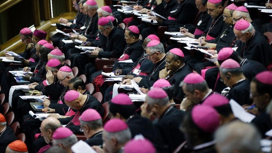 Bishops attend a morning session of a two-week synod on family issues at the Vatican, Monday, Oct. 13, 2014. (AP Photo/Gregorio Borgia)