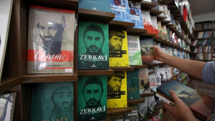 Books about Osama bin Laden and other Islamic leaders are displayed at an Islamic bookstore in the Fatih district of Istanbul, Monday, Oct. 13, 2014. A Sept. 26 clash, described to The Associated Press by university students, is one of the clearest signs that the radical Islamic State group has sympathizers in Istanbul, a cosmopolitan metropolis better known to tourists for its Ottoman architecture and vibrant nightlife. (AP Photo/Emrah Gurel)