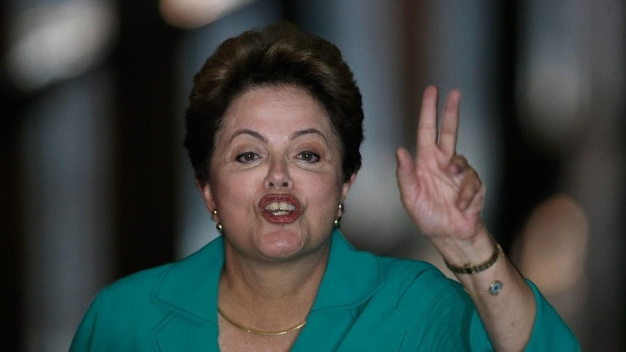 Brazil's President Dilma Rousseff, who is running for re-election with the Workers Party, PT, speaks during a campaign news conference at the Alvorada Palace, in Brasilia, Brazil, Monday, Oct. 13, 2014. President Rousseff will face challenger Aecio Neves in a second-round vote in Brazil's most unpredictable presidential election since the nation's return to democracy nearly three decades ago. (AP Photo/Eraldo Peres)