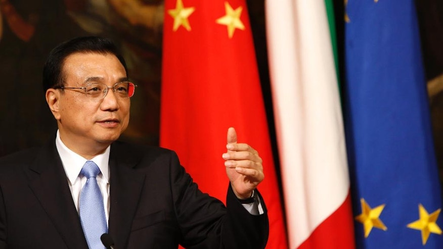 Chinese Prime Minister Li Keqiang attends a joint press conference with Italian Premier Matteo Renzi, not pictured, at the end of their meeting at Chigi Palace government office in Rome, Tuesday, Oct. 14, 2014. (AP Photo/Riccardo De Luca)