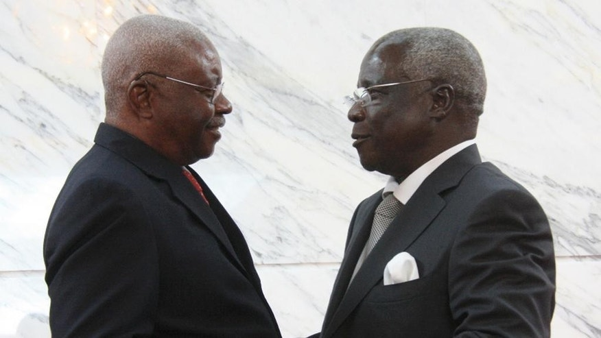FILE-  In this file photo dated Friday, Sept. 5, 2014, Mozambique President Arnando Guebuza, left, and former Renamo rebel leader Afonso Dhlakama, shake hands after signing a peace accord in Maputo, Mozambique. Dhlakama returned to the capital after a two year absence, to take part in elections to take place Wednesday Oct. 15. 2014.  (AP Photo/Ferhat Momade-FILE)