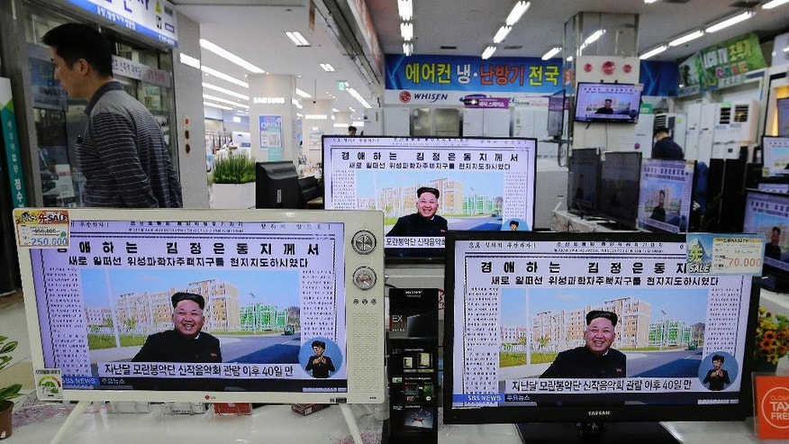 "TV monitors show a news report about North Korean leader Kim Jong Un, at an electronic shop, South Korea, Tuesday, Oct. 14, 2014. Kim has made his first public appearance in five weeks, state media reported Tuesday, ending an absence that drove a frenzy of global speculation that something was amiss with the country's most powerful person. The letters read "" Honorable Kim Jong Un"". (AP Photo/Ahn Young-joon)"