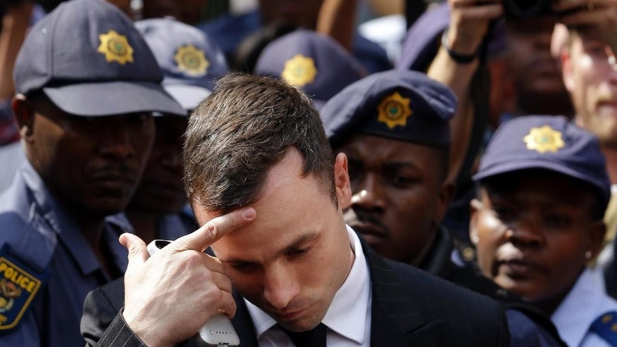 Oscar Pistorius leaves the high court in Pretoria, South Africa, Monday, Oct. 13, 2014. = Pistorius faces sentencing this week in a South African court after being convicted of culpable homicide for killing girlfriend Reeva Steenkamp. Judge Thokozile Masipa found Pistorius not guilty of both premeditated murder and murder in his killing of Steenkamp in the predawn hours of Valentine's Day at his home last year.  (AP Photo/Themba Hadebe)