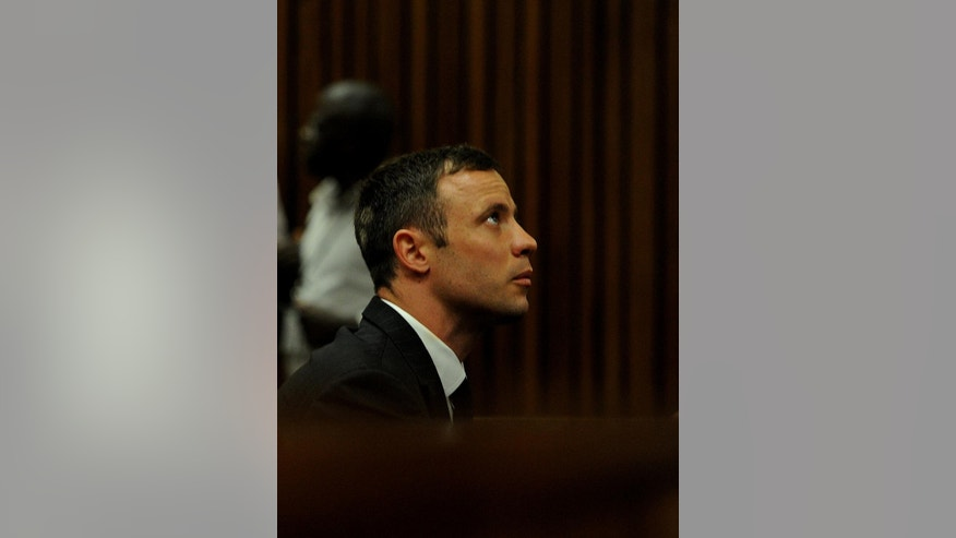Oscar Pistorius in court Monday, Oct. 13, 2014 to face sentencing for the shooting death of his girlfriend Reeva Steenkamp. South African judge Thokozile Masipa has wide latitude in deciding the sentence after several days of legal arguments and testimony that begin Monday. Last month she convicted the double-amputee runner of culpable homicide, or negligent killing. Sentences for such a crime can range from a suspended sentence and a fine to as many as 15 years in prison. (AP Photo/Werner Beukes. Pool)