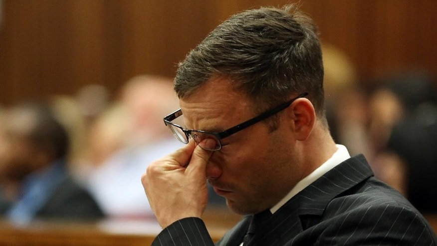 "Oscar Pistorius rubs his eyes as he sits in court as the sentencing process entered a second day, Pretoria, South Africa, Tuesday  Oct. 14, 2014. Pistorius was being portrayed as a ""poor victim"" ahead of his sentencing for killing girlfriend Reeva Steenkamp, the chief prosecutor said Tuesday. (AP Photo/Themba Hadebe, Pool)"
