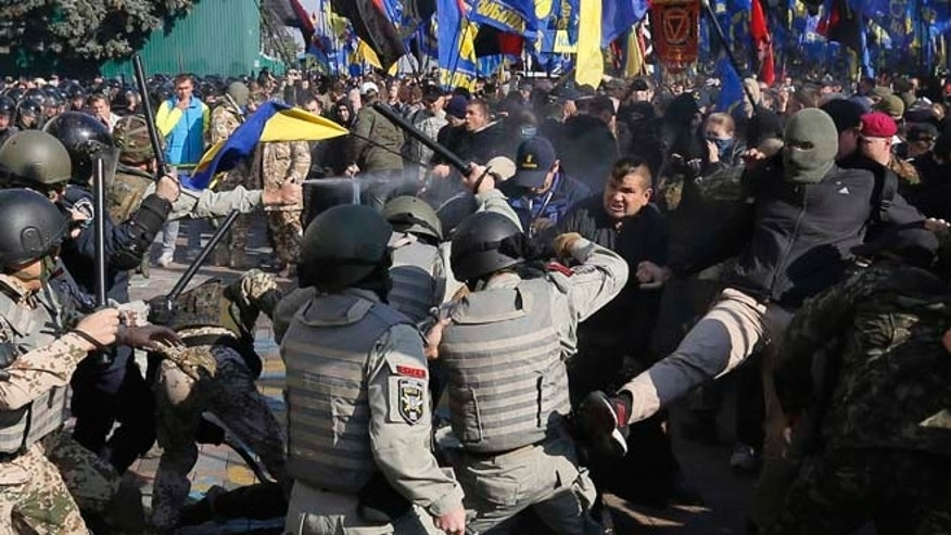 Oct. 14, 2014: Police clash with demonstrators outside parliament in Kiev, Ukraine, as deputies repeatedly voted down proposals to officially recognize a contentious WWII-era partisan group as national heroes.