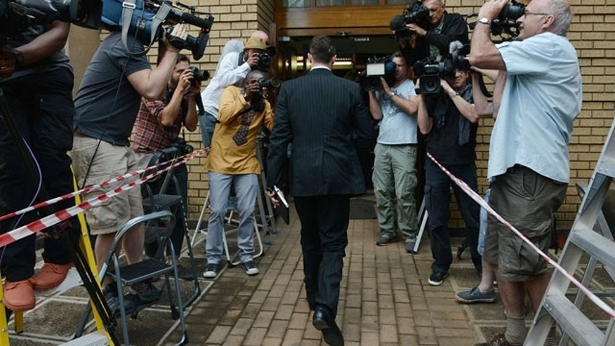 October 14, 2014: Oscar Pistorius enters court to face day two of sentencing processes for the shooting death of his girlfriend Reeva Steenkamp. Pistorius was found guilty last month on a culpable homicide charge. (AP Photo)