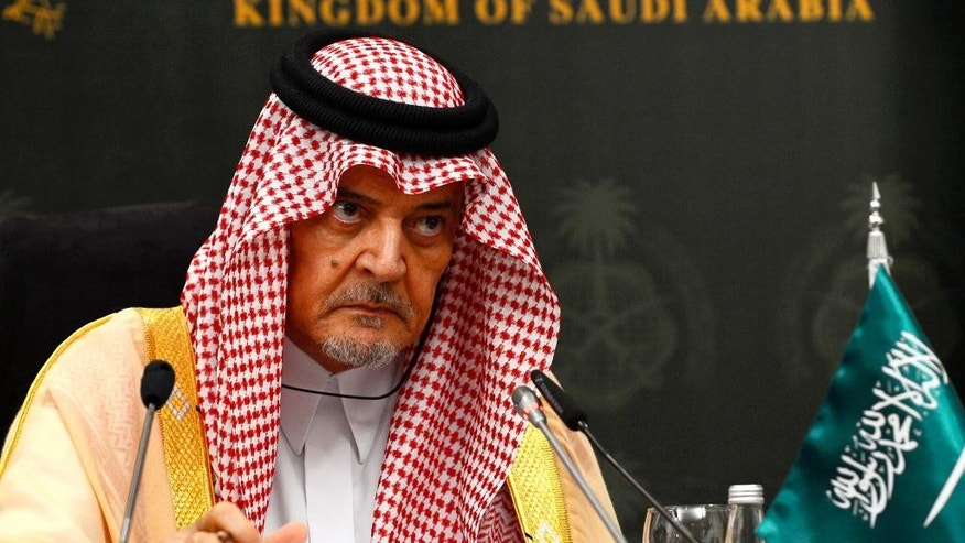 """In this Monday, Oct. 13, 2014 photo, released by Saudi Press Agency, Saudi Arabia's Foreign Minister Saud al-Faisal gives a press conference with German Foreign Minister Frank-Walter Steinmeier, in Jiddah, Saudi Arabia. Al-Faisal accused Tehran on Monday of having forces inside Syria, Iraq and Yemen, and insisted that Iran is """"part of the problem"""" in trying to defuse a myriad of Mideast crises.  Iran's state news agency is reporting Tuesday, Oct. 14, 2014, that the Islamic Republic's Foreign Ministry has warned Saudi Arabia that comments calling it """"part of the problem"""" in the Middle East may damage diplomatic ties. Saudi Arabia, a Sunni powerhouse, and Iran, the dominant Shiite force in the Middle East, long have viewed each other with suspicion. (AP Photo/SPA)"""