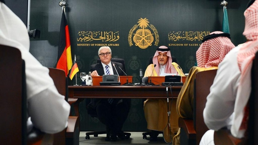 """In this Monday, Oct. 13, 2014 photo, released by Saudi Press Agency, Saudi Arabia's Foreign Minister Saud al-Faisal, gives a press conference with German Foreign Minister Frank-Walter Steinmeier, in Jiddah, Saudi Arabia. Al-Faisal accused Tehran on Monday of having forces inside Syria, Iraq and Yemen, and insisted that Iran is """"part of the problem"""" in trying to defuse a myriad of Mideast crises.  Iran's state news agency is reporting Tuesday, Oct. 14, 2014, that the Islamic Republic's Foreign Ministry has warned Saudi Arabia that comments calling it """"part of the problem"""" in the Middle East may damage diplomatic ties. Saudi Arabia, a Sunni powerhouse, and Iran, the dominant Shiite force in the Middle East, long have viewed each other with suspicion. (AP Photo/SPA)"""
