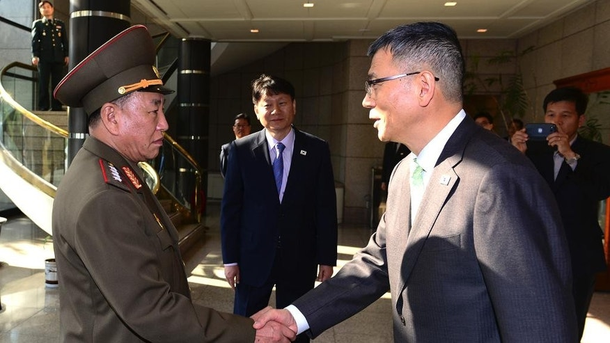 In this photo released by South Korean Defense Ministry, North Korean delegation chief Kim Yong Chol, left, shakes hands with his South Korean counterpart, Deputy Minister for National Defense Policy Ryu Je-seung before their meeting at the border villages of Panmunjom, South Korea, Wednesday, Oct. 15, 2104. The first military talks between North and South Korea in more than three years ended with no agreement Wednesday, with the rivals failing to narrow their differences on how to ease animosities following two shooting incidents last week, South Korean officials said. (AP Photo/Defense Ministry)