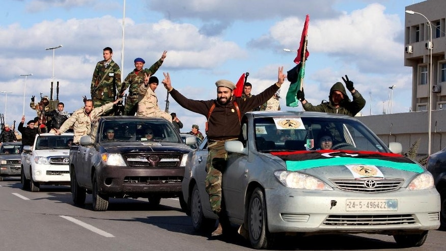 FILE - In this Tuesday, Feb. 14, 2012 file photo, Libyan militias from towns throughout the country's west parade through Tripoli, Libya. The chaos unleashed by the Arab Spring has led to the rise of powerful militias across the Middle East, some allied with governments, others fighting to topple them and some -- like the Kurdish peshmerga in northern Iraq -- seen as vital Western allies. All could prove to be major obstacles to bringing peace or stability to the troubled region (AP Photo/Abdel Magid Al Fergany, File)