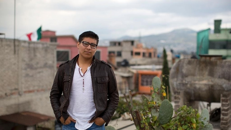In this Friday, Oct. 3, 2014 photo, Dario Guerrero stands for a portrait on the rooftop of his grandparents' home in the outskirts of Mexico City. Guerrero, a Harvard University junior, accompanied his dying mother to Mexico without government permission, and is now unable to return to the United States. (AP Photo/Dario Lopez-Mills)