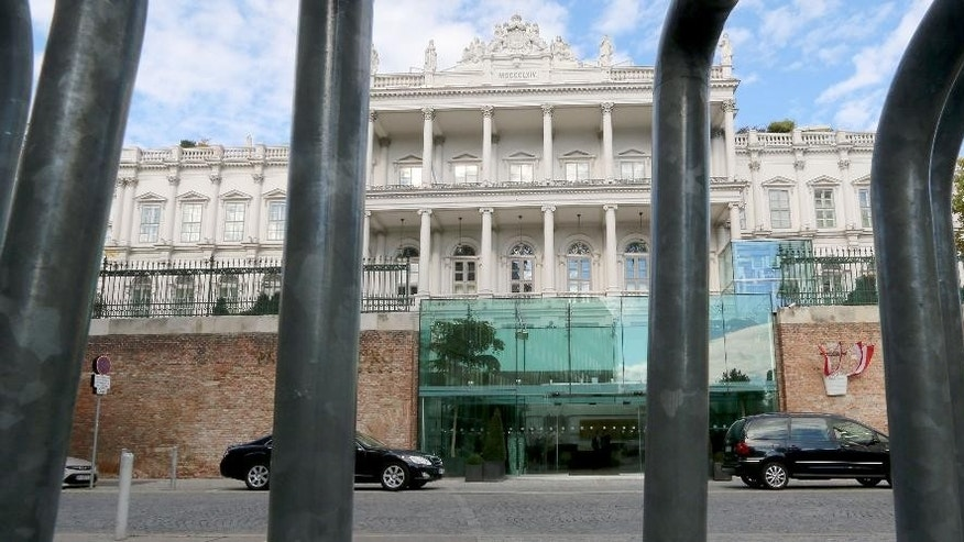 The entrance of Hotel Palais Coburg is pictured through a police barrier where closed-door nuclear talks take place in Vienna, Austria,  Tuesday, Oct. 14, 2014. With differences still unresolved and the deadline for a deal nearing, Iran and the U.S. have a choice to make: Extend nuclear talks for a second time or face the risk of renewed confrontation and armed conflict. U.S. Secretary of State John Kerry meets Wednesday in Vienna with Iranian Foreign Minister Mohammad Javad Zarif to try and advance the talks and meet the target date of Nov. 24. (AP Photo/Ronald Zak)