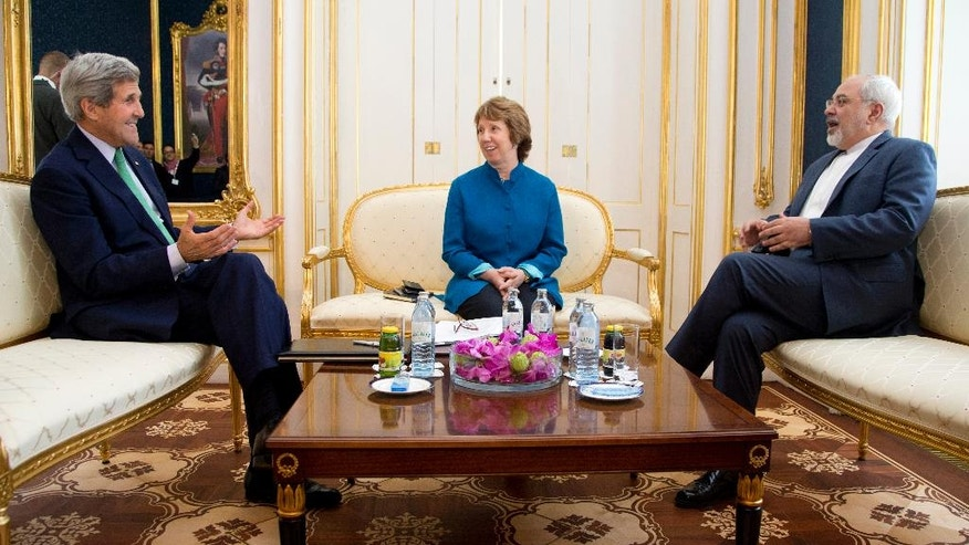 From left, U.S. Secretary of State John Kerry, European Union High Representative Catherine Ashton, and Iranian Foreign Minister Mohammad Javad Zarif are photographed as they participate in a trilateral meeting in Vienna, Austria, Wednesday, Oct. 15, 2014. The three will try and advance nuclear talks and meet the target date of Nov. 24. But with less than six weeks left until Nov. 24, there may be no alternative than to prolonging them. (AP Photo/Carolyn Kaster, Pool)
