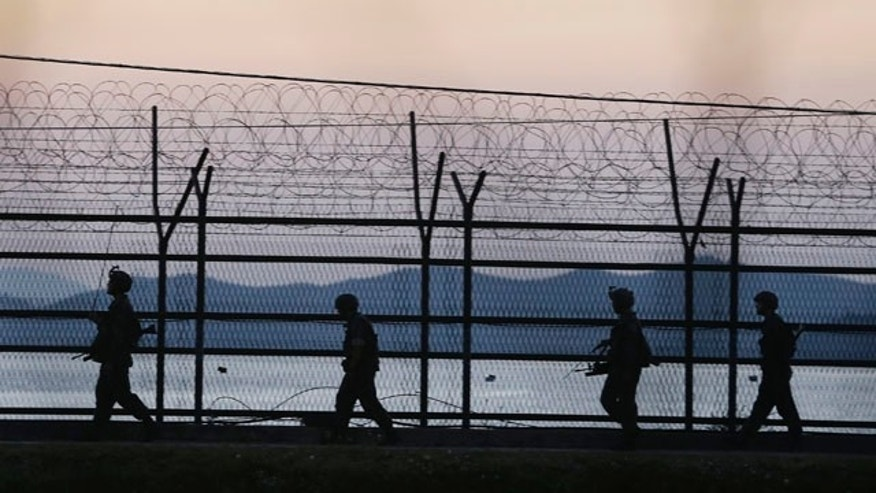 October 7, 2014: South Korean army soldiers patrol through the wire fences near the demilitarized zone between the two Koreas in Paju, South Korea. (AP Photo/Ahn Young-joon)