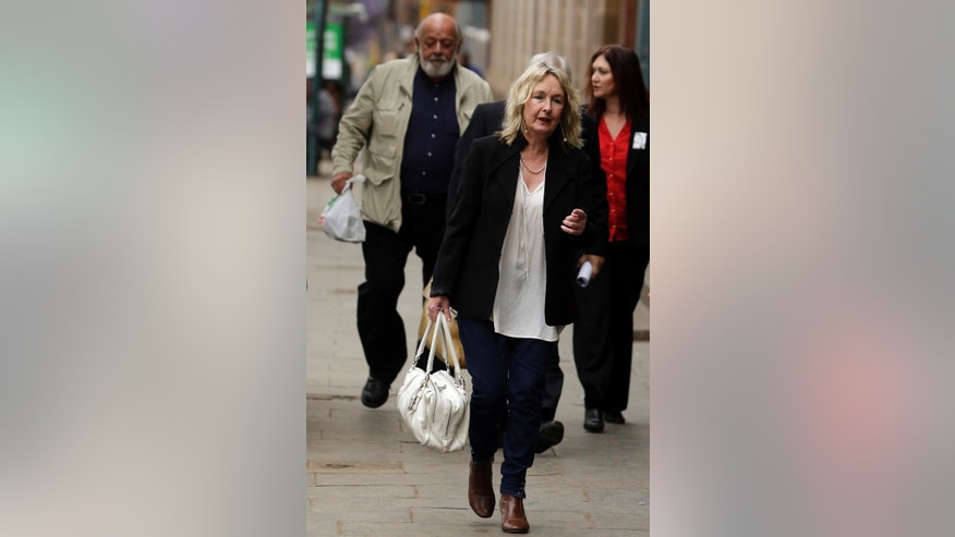 June Steenkamp, mother of Reeva Steenkamp, and her husband Barry, left, accompanied by an unidentified woman arrive for the Oscar Pistorius mitigation of sentencing at the high court in Pretoria, South Africa, Wednesday, Oct. 15, 2014. Pistorius faces sentencing this week in the South African court after being convicted of culpable homicide for killing girlfriend Reeva. (AP Photo/Themba Hadebe)