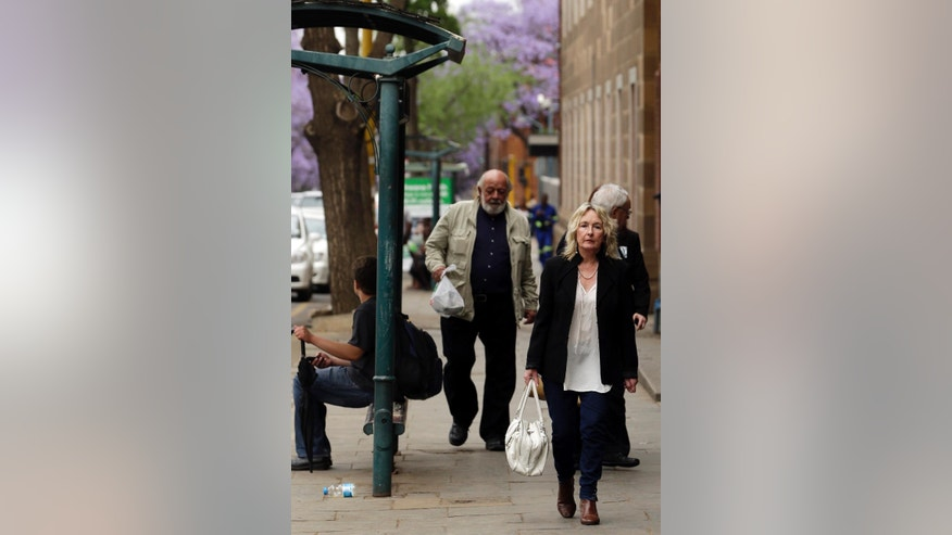 June Steenkamp, foreground, mother of Reeva Steenkamp, and her husband Barry, left, arrive for the Oscar Pistorius mitigation of sentencing at the high court in Pretoria, South Africa, Wednesday, Oct. 15, 2014. Pistorius faces sentencing this week in the South African court after being convicted of culpable homicide for killing girlfriend Reeva Steenkamp. (AP Photo/Themba Hadebe)