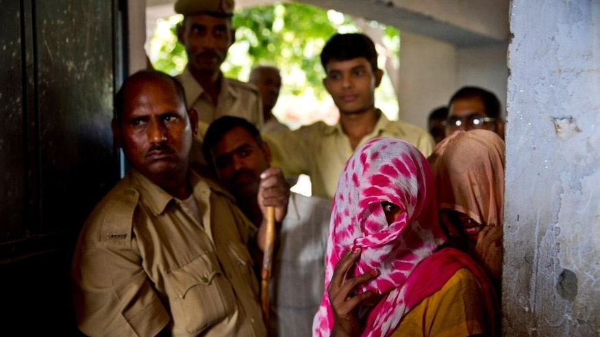 Voters line up to cast their votes during the Haryana state elections in Gwalpur Pahari, India, Wednesday, Oct. 15, 2014. The Indian states Haryana and Maharashtra are going to the polls Wednesday to elect representatives to their respective state Assemblies. (AP Photo/Saurabh Das)