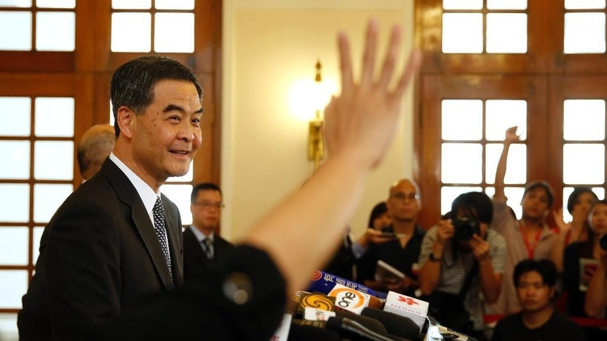 Hong Kong Chief Executive Leung Chun-ying answers questions during a press conference in Hong Kong Government House,Thursday, Oct. 16, 2014. Leung said officials have been negotiating with the students through middlemen in the past few days, and announced that authorities are keen to discuss details of democratic reform with them. (AP Photo/Kin Cheung)