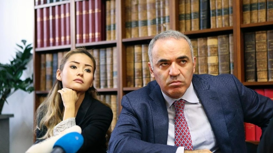 Russian chess master and political activist Garry Kasparov ponders a question as he sits with Kazakh banker Mukhtar Ablyazov's daughter Madina Ablyazova during a press conference in Paris, Thursday Oct. 16, 2014. Kasparov said  Mukhtar Ablyazov is in danger if a court rules he should be extradited from France. The case of Mukhtar Ablyazov has been tangled up in courts in at least five countries since he fled Kazakhstan amid the nationalization of BTA Bank, which he had led. Ablyazov is jailed in France as Russia and Ukraine seek his extradition over billions missing from the bank. He was arrested in France on an international warrant. (AP Photo/Remy de la Mauviniere)
