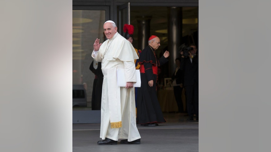 Pope Francis waves as he arrives at a morning session of a two-week synod on family issues, at the Vatican, Thursday, Oct. 16, 2014. (AP Photo/Alessandra Tarantino)