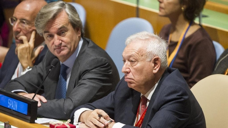 In this photo provided by the United Nations, José Manuel García-Margallo, right, Foreign Minister of Spain, attends a meeting of the U.N. General Assembly, Thursday, Oct. 16, 2014 at U.N. headquarters.(AP Photo/United Nations, Mark Garten)