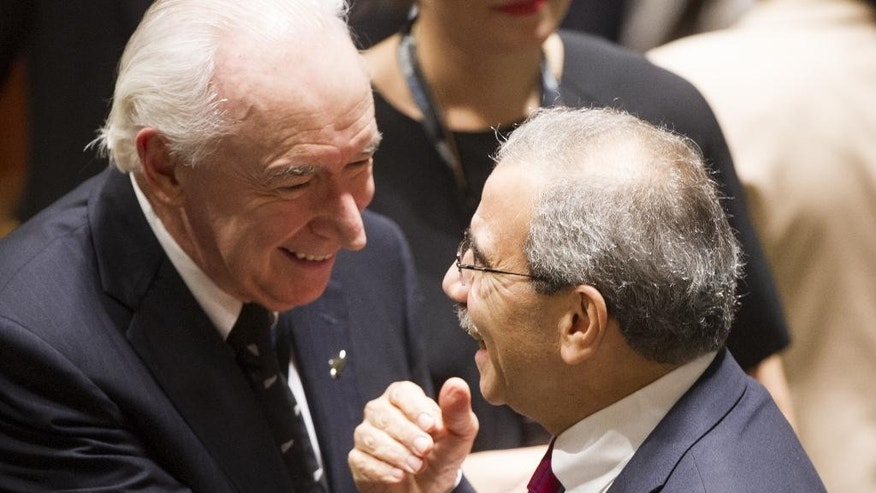 In this photo provided by the United Nations, Jim McLay, left, New Zealand's U.N. ambassador, talks with Nawaf Salam, Lebanon's ambassador, during a meeting of the U.N. General Assembly, Thursday, Oct. 16, 2014 at U.N. headquarters.  (AP Photo/United Nations, Mark Garten)